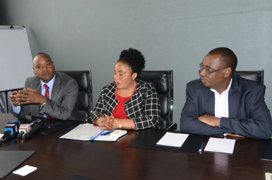 The Executive Director of the East African Business Council, Hon Peter Mathuki (left), at the media briefing. With him are Kenya's EAC Principal Secretary Dr. Margret Mwakima and Mr. Kenneth Bagamuhunda, the Director General, Customs and Trade at the EAC Secretariat.