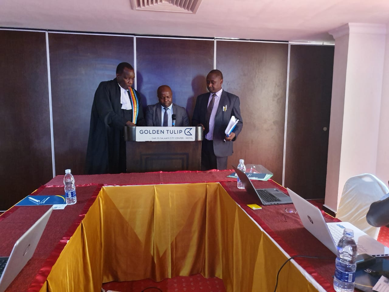 The Counsel to the Community, Dr. Anthony Kafumbe (on the right), the Registrar of the East African Court of Justice, Mr. Yufnalis N. Okubo (on the left) and Dr. John K. Mduma (centre) at the swearing in ceremony.