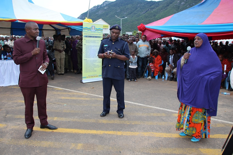 Arusha Regional Commissioner, Mr. Mrisho Gambo listen to one of  participant of the sensitization  at Namanga town