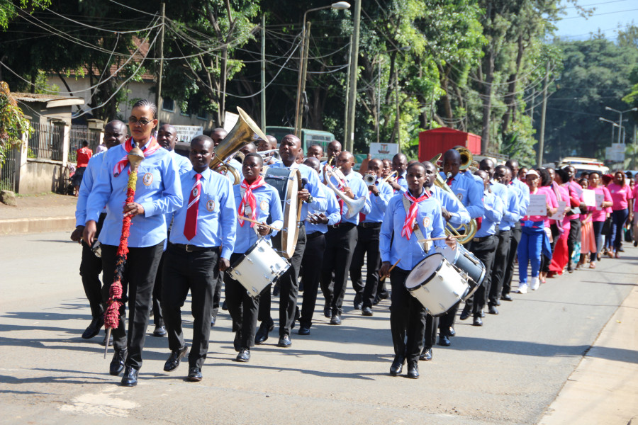 The Tanzania Peoples' Defence Forces Monduli Military Academy Band leads the procession through the streets of Arusha during celebrations by the EAC to mark the International Women's Day 2020.
