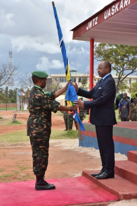 Tanzania's Minister of Defence and National Service, Hon. Dr. Hussein Ali Mwinyi handing over the EAC Flag to the Command Post Exercise Director symbolizing the official launch of the Exercise
