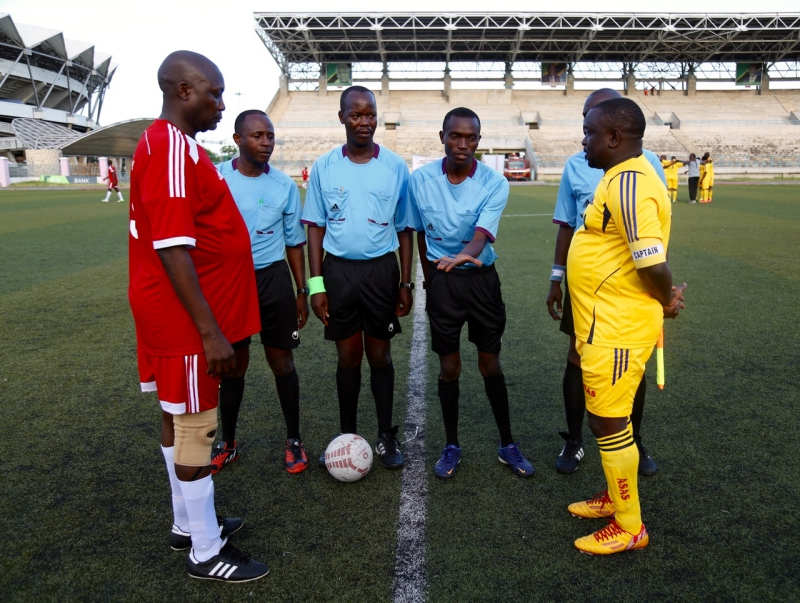 EALA Captain, Kenneth Madete (left) and the Captain of the Bunge Sports Club, Tanzania, Hon Gibson Ole Meseyiek look on as the referee tosses a coin at the start of the match.  Parliament of Kenya beat Parliament of Tanzania 6-0 in an entertaining match