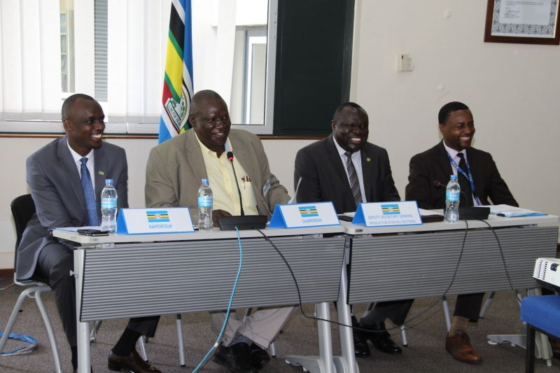 The Chairperson of the 5th Sectoral Council on Environment and Natural Resources, Mr. Mugabi Stephen David, speaking at the opening session of the meeting. With him are, from left, Mr. Jean Kizito of the Rwanda High Commission; Hon. Christophe Bazivamo, EAC Deputy Secretary General in charge of Productive and Social Sectors, and; Mr. Jean Baptiste Havugimana, Director Productive Sectors at the EAC Secretariat.