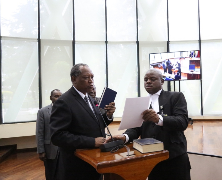 The Minister for Foreign Affairs and East African Co-operation, United Republic of Tanzania, Prof Palamagamba Kabudi takes the oath of Allegiance administered by EALA Clerk Assistant, Victor Manzi.