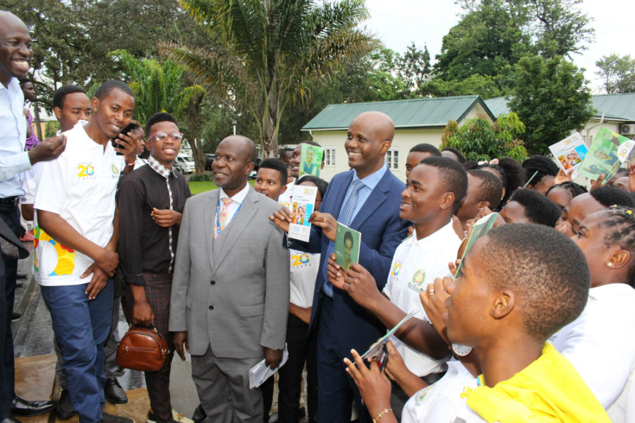 EAC Secretary General Amb. Liberat Mfumukeko (centre), Director of Trade Alhaji Rashid Kibowa (in grey suit), and participants hold campaign booklets shortly after the launch outside the EAC Headquarters.