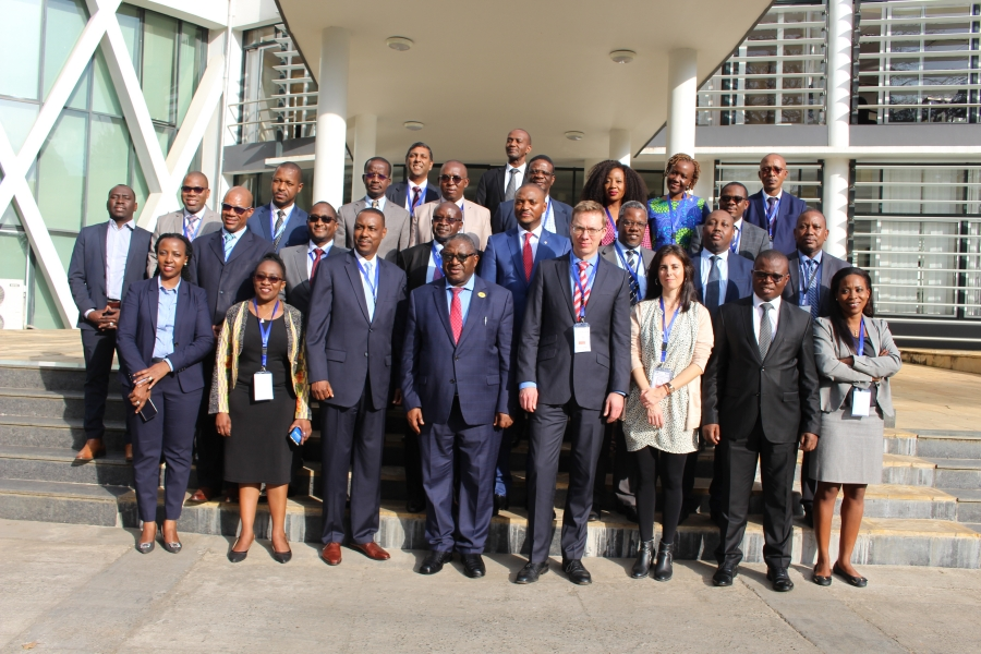 A group photo of participants at the 30th NEPAD-IPPF Oversight Committee Meeting outside the EAC Headquarters in Arusha, Tanzania.