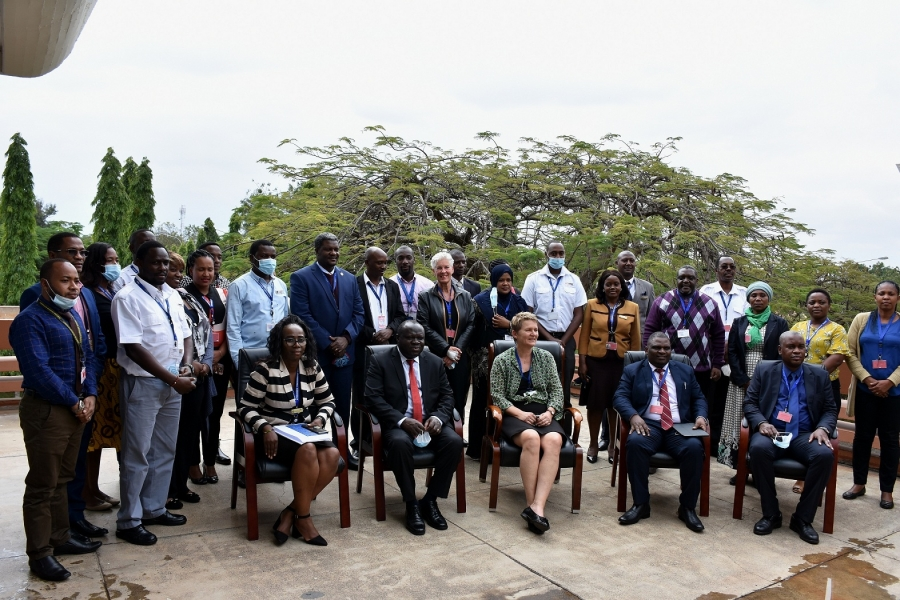 Hon Christophe Bazivamo EAC-Deputy Secretary General-Productive and Social Sectors, H.E. Regine Hess Germany Ambassador to Tanzania and EAC flanked by Kilimanjaro International Airport staff trainees.
